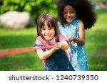 little girls play fun game at... | Shutterstock . vector #1240739350