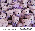 Small photo of Pile of lilac plushy bears
