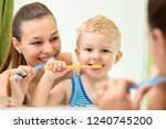 pretty woman and her child son... | Shutterstock . vector #1240745200