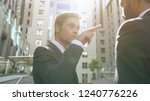 young aggressive businessman... | Shutterstock . vector #1240776226