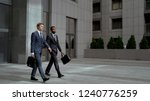 two coworkers leaving business... | Shutterstock . vector #1240776259