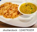 malabar parantha with korma... | Shutterstock . vector #1240793359
