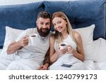 happy couple lying in bed and... | Shutterstock . vector #1240799173