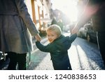 a rear view of small toddler... | Shutterstock . vector #1240838653