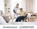 a health visitor helping a... | Shutterstock . vector #1240839289