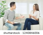 portrait of smiling couple on... | Shutterstock . vector #1240846006