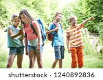 group of children geocaching in ... | Shutterstock . vector #1240892836