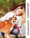 Stock photo pretty girl with his shetland sheepdog dog at nature park outdoor is standing and posing in front 1240894789