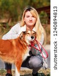 Stock photo pretty girl with his shetland sheepdog dog at nature park outdoor is standing and posing in front 1240894813