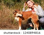 Stock photo pretty girl with his shetland sheepdog dog at nature park outdoor is standing and posing in front 1240894816