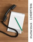 handset  pencil and notepad on... | Shutterstock . vector #1240897846