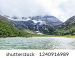 valley lake view under the the... | Shutterstock . vector #1240916989