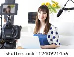 portrait of female vlogger... | Shutterstock . vector #1240921456