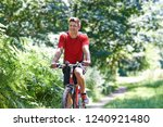 active man cycling along path... | Shutterstock . vector #1240921480