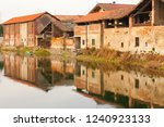old buildings on the banks of a ... | Shutterstock . vector #1240923133