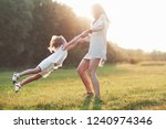 holding by the hands and... | Shutterstock . vector #1240974346