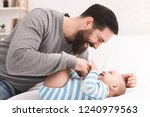 babysitting is fun. father... | Shutterstock . vector #1240979563