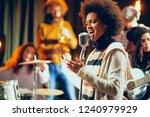 close up of mixed race woman...   Shutterstock . vector #1240979929