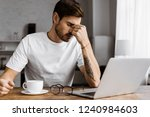 tired young freelancer with... | Shutterstock . vector #1240984603