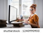 smiling young woman working on... | Shutterstock . vector #1240990903