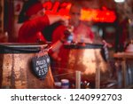 pots of mulled wine in a stall... | Shutterstock . vector #1240992703
