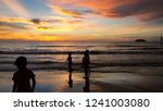 malay kids play on tanjung aru... | Shutterstock . vector #1241003080