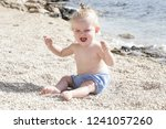 candid photo of adorable blonde ... | Shutterstock . vector #1241057260