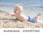 candid photo of adorable blonde ... | Shutterstock . vector #1241057263
