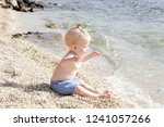 candid photo of adorable blonde ... | Shutterstock . vector #1241057266