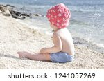 candid photo of adorable blonde ... | Shutterstock . vector #1241057269