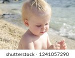 candid photo of adorable blonde ... | Shutterstock . vector #1241057290