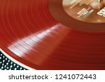 vinyl record closeup. a ray of... | Shutterstock . vector #1241072443