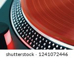 vinyl record closeup. a ray of... | Shutterstock . vector #1241072446
