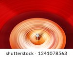 vinyl record rotate. a ray of... | Shutterstock . vector #1241078563