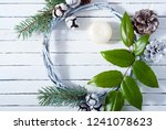 christmas wreath on white wood... | Shutterstock . vector #1241078623