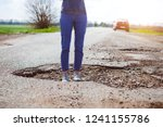 bad roads   a girl stands in a... | Shutterstock . vector #1241155786