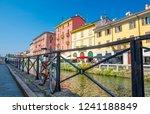 bike near railing of naviglio... | Shutterstock . vector #1241188849