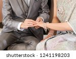 the groom put a wedding ring... | Shutterstock . vector #1241198203
