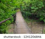 suspension bridge over mountain ... | Shutterstock . vector #1241206846