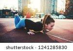 push ups. young sportswoman... | Shutterstock . vector #1241285830