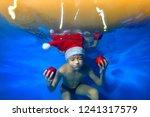 a little boy is swimming...   Shutterstock . vector #1241317579