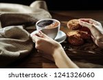 hands holding cookie and coffee ... | Shutterstock . vector #1241326060