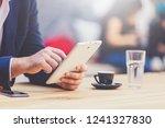 man using digital tablet in...   Shutterstock . vector #1241327830