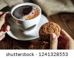female hands holding cup of... | Shutterstock . vector #1241328553