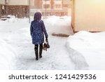 back of woman in dawn jacket... | Shutterstock . vector #1241429536