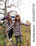 family having fun outdoors | Shutterstock . vector #1241432719