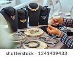 elegantly dressed woman makes... | Shutterstock . vector #1241439433