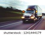 semi truck on highway concept... | Shutterstock . vector #1241444179