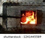 burning fire in rustic stove.... | Shutterstock . vector #1241445589