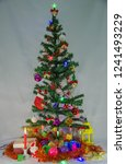 christmas tree with beautiful... | Shutterstock . vector #1241493229